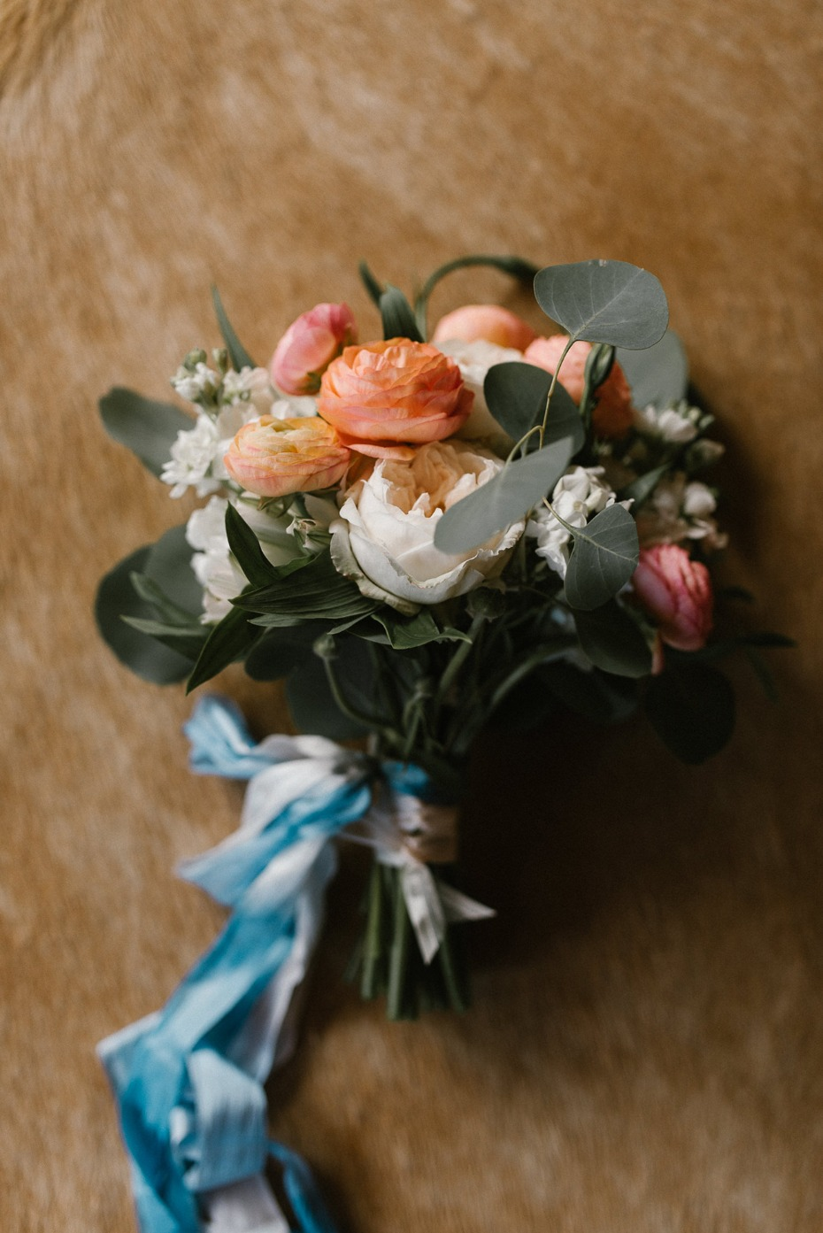 Brides bouquet with blue ribbons