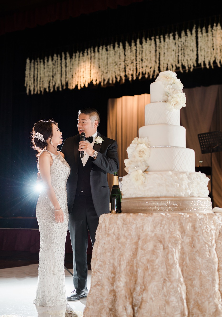 bride and groom and their towering cake