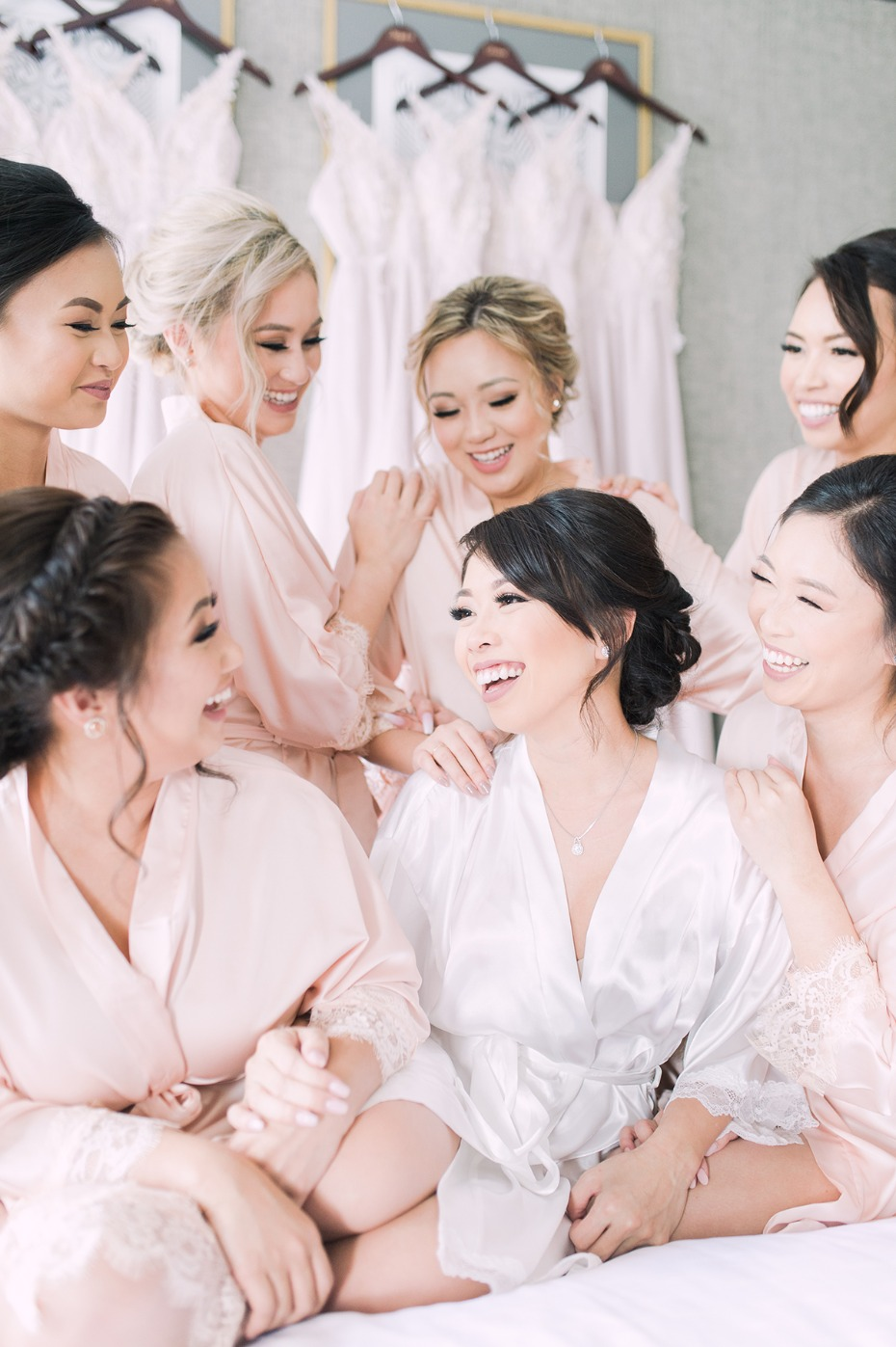 a bride and her bridesmaids getting wedding ready