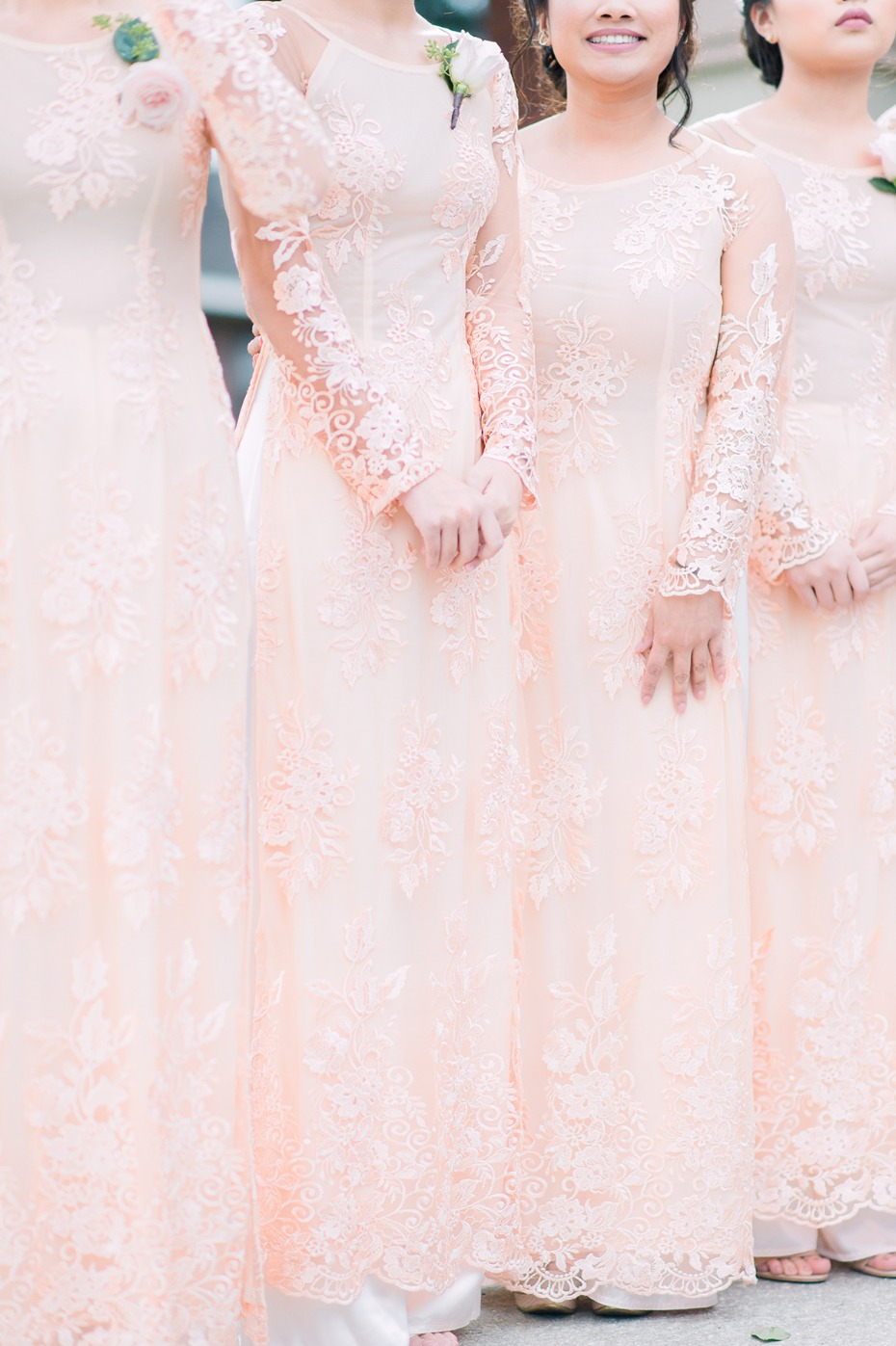 bridesmaids in long sleeve blush dresses