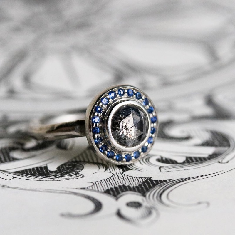 As though plucked from a ancient Rome, this ring is like wearing a piece of history your finger. The sparkling round rose cut galaxy
