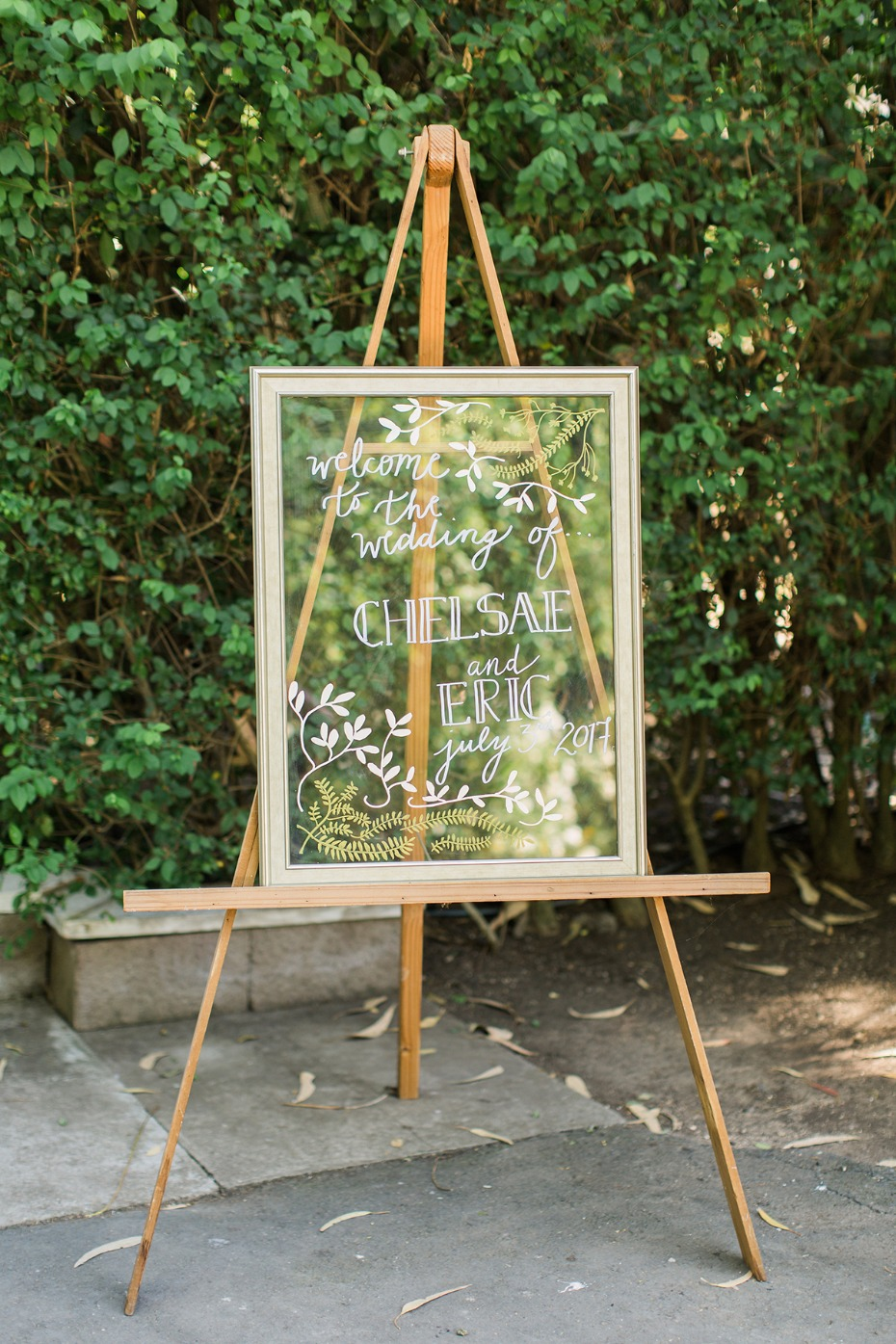 glass framed wedding sign