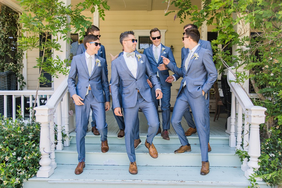 groom and his men in matching blue suits