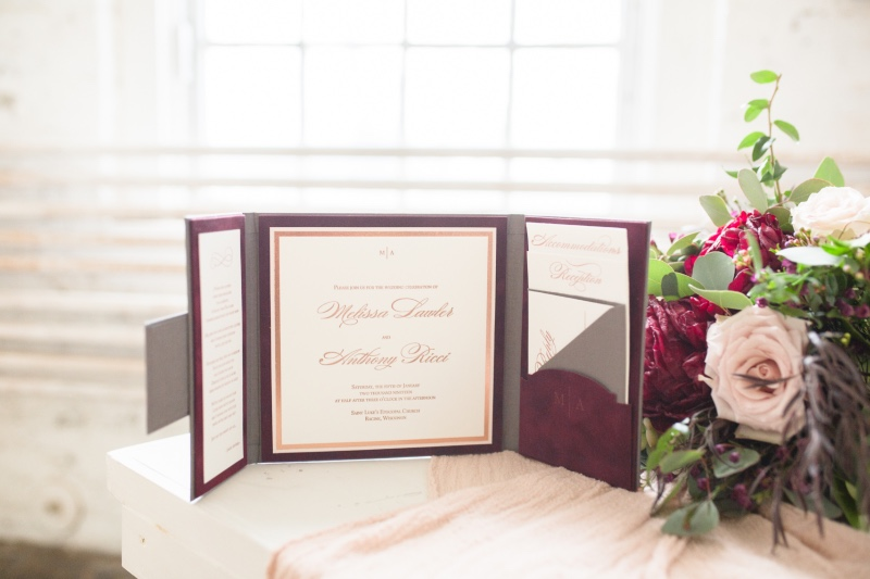 A modified gatefold letterpress wedding invitation suite with rich, romantic tones like gray, burgundy velvet, blush and rose gold