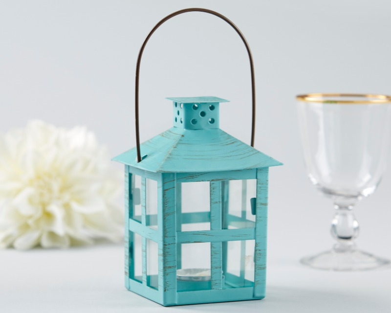 As favors, as part of centerpieces, or as a means of lighting your walk down the aisle, this Vintage Blue Distressed Lantern is guaranteed