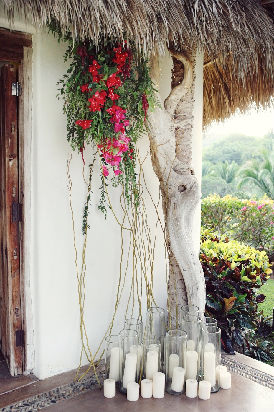 hanging tropical florals and pillar candles