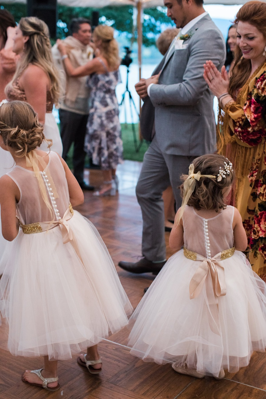 flower girls in tulle skirts and wedding halos