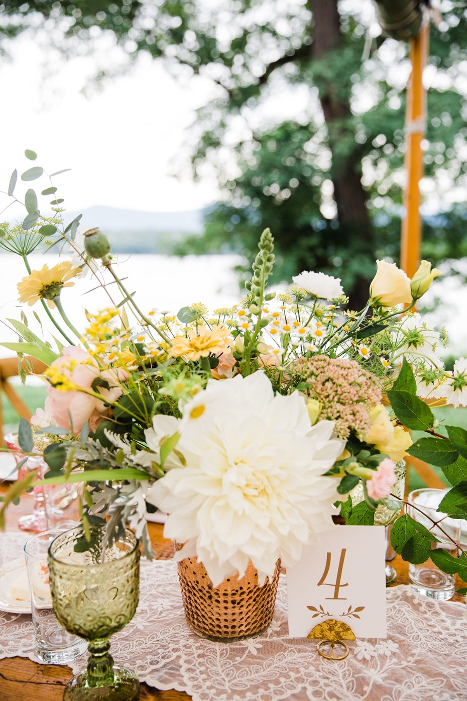 bright and summer inspired wedding floral centerpiece