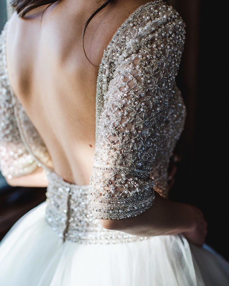 Beautiful wedding dress details are always a must.