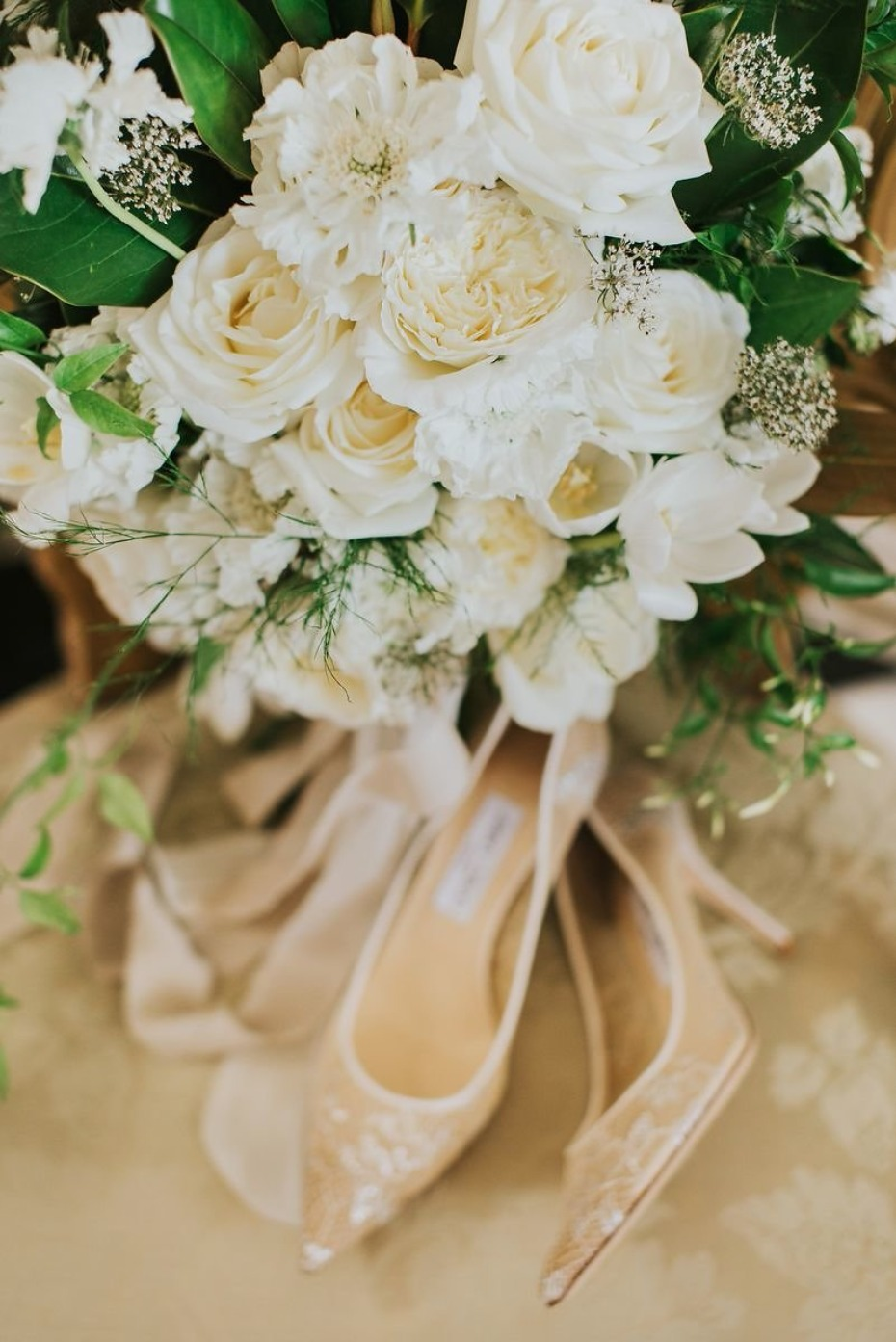wedding shoes and all white wedding bouquet
