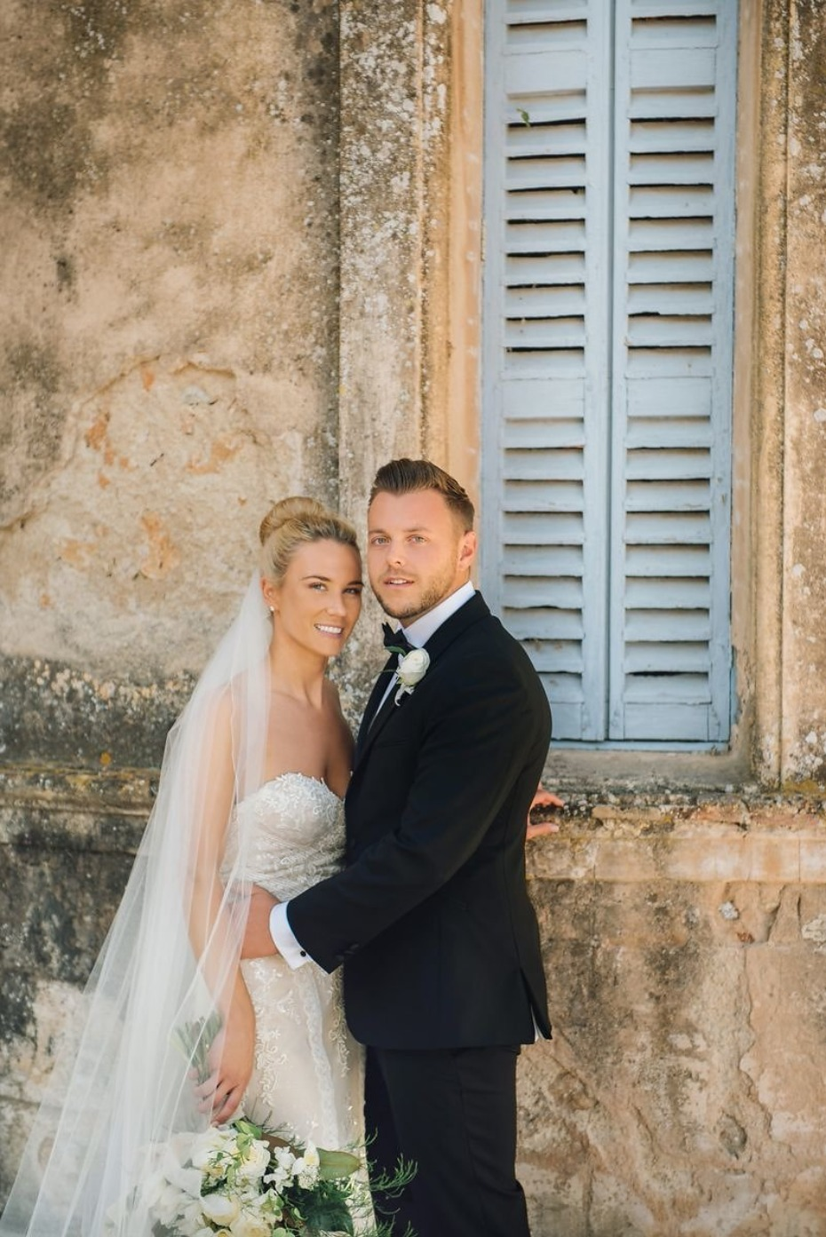 a bride and a groom at their formal French wedding