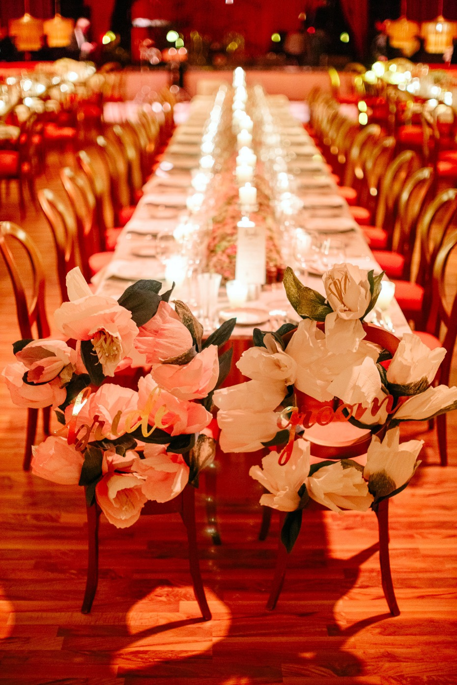bride and groom wedding seats with giant paper flowers