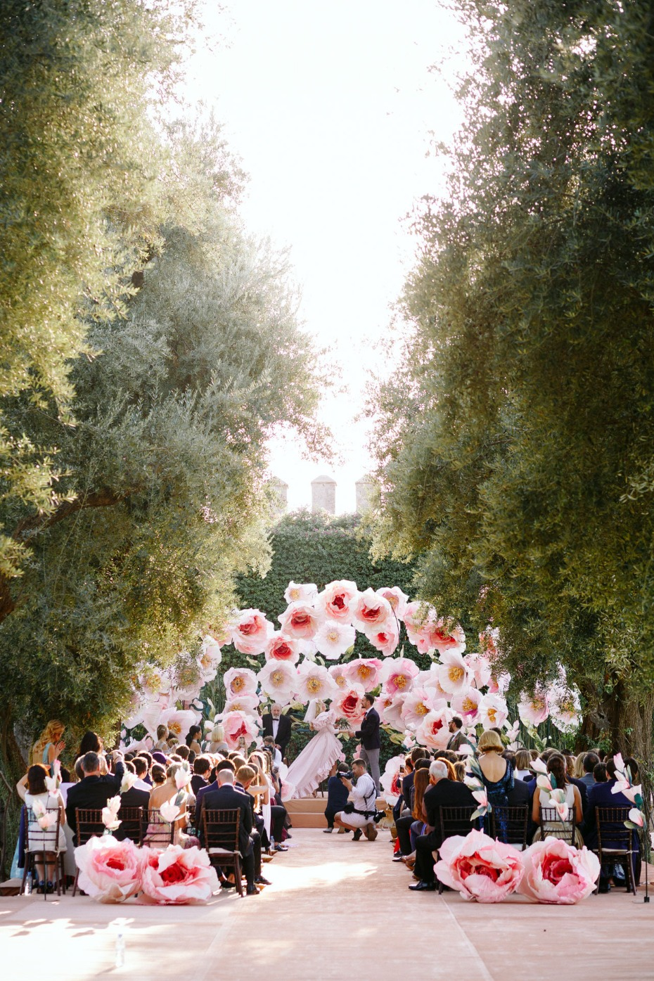 wedding ceremony with giant paper flowers