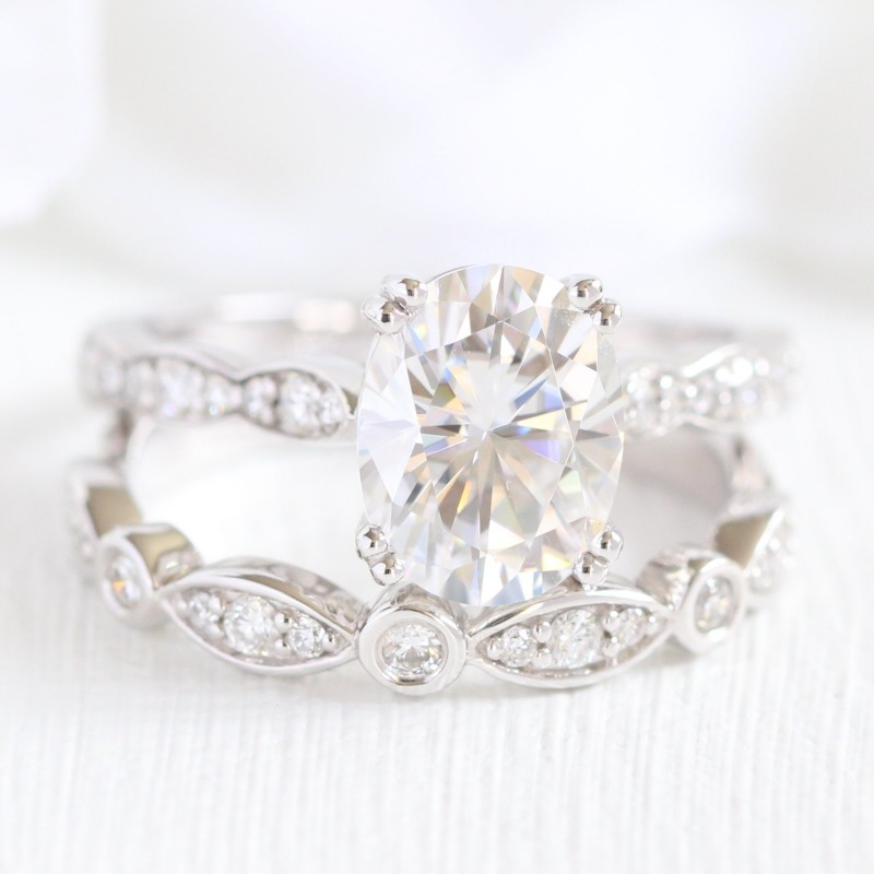 Shop this Oval Forever One Moissanite Solitaire Engagement Ring in Scalloped Diamond Band with Bezel Scalloped Diamond Wedding Band