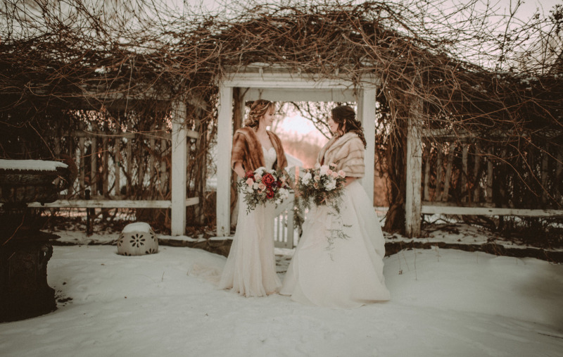 Ashlee and Cherisse's snowy New Year's Eve wedding at FEAST at Round Hill, Hudson Valley wedding venue. Photography by Allison Markova