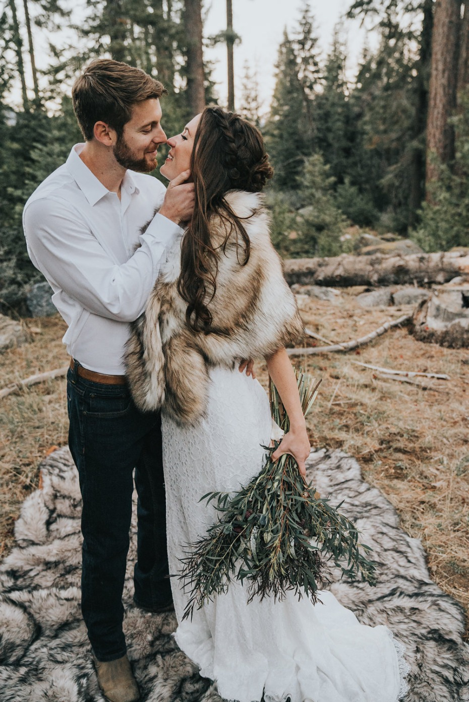 bride and groom in mountain chic wedding attire