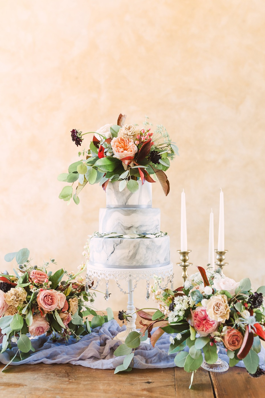 flower topped marbled wedding cake