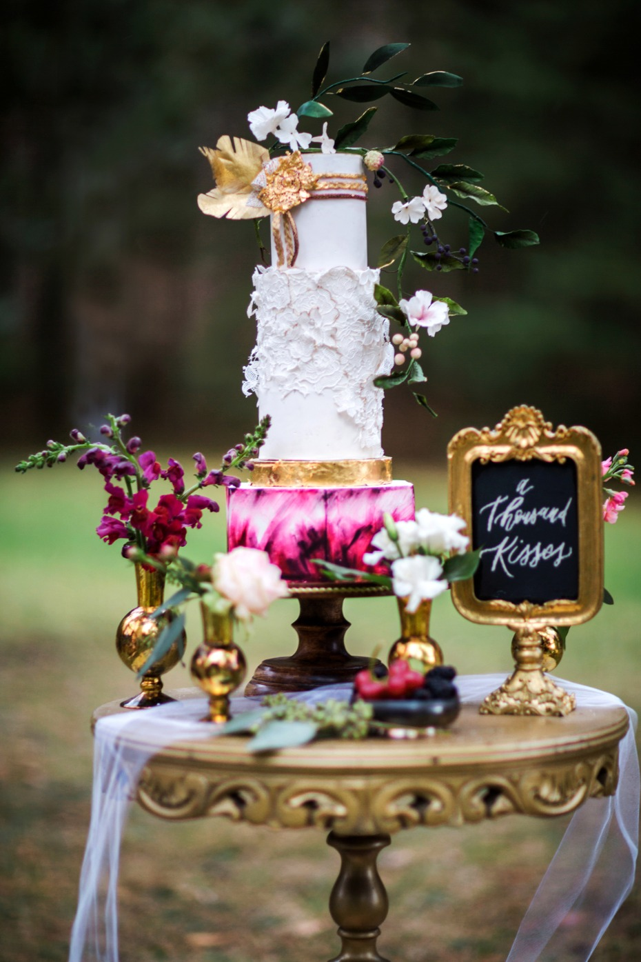 wedding cake with gold leaf accents