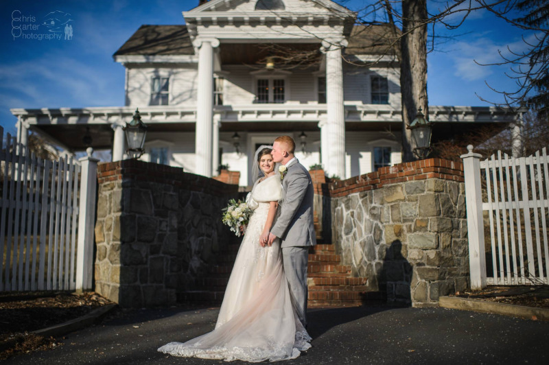 Couple in front of FEAST at Round Hill, Hudson Valley, New York, wedding venue. Photo by Chris Carter Photography.