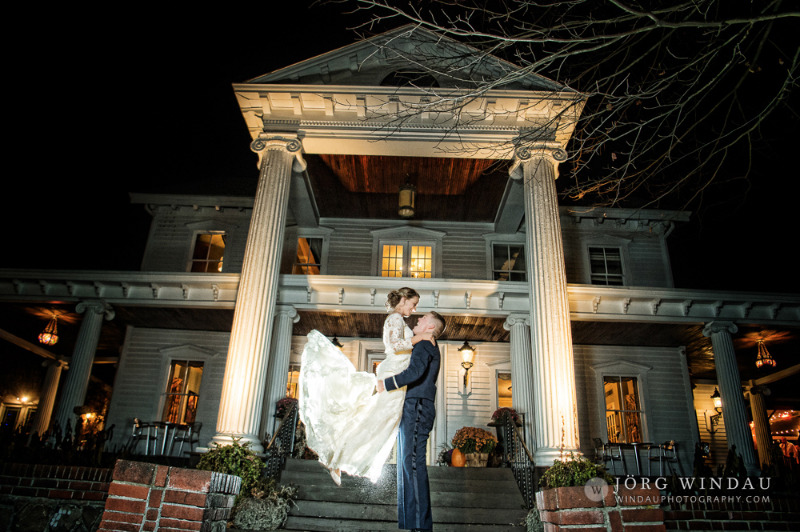 Romantic night shot in front of FEAST at Round Hill, Hudson Valley wedding venue. Photo by Windau Photography.