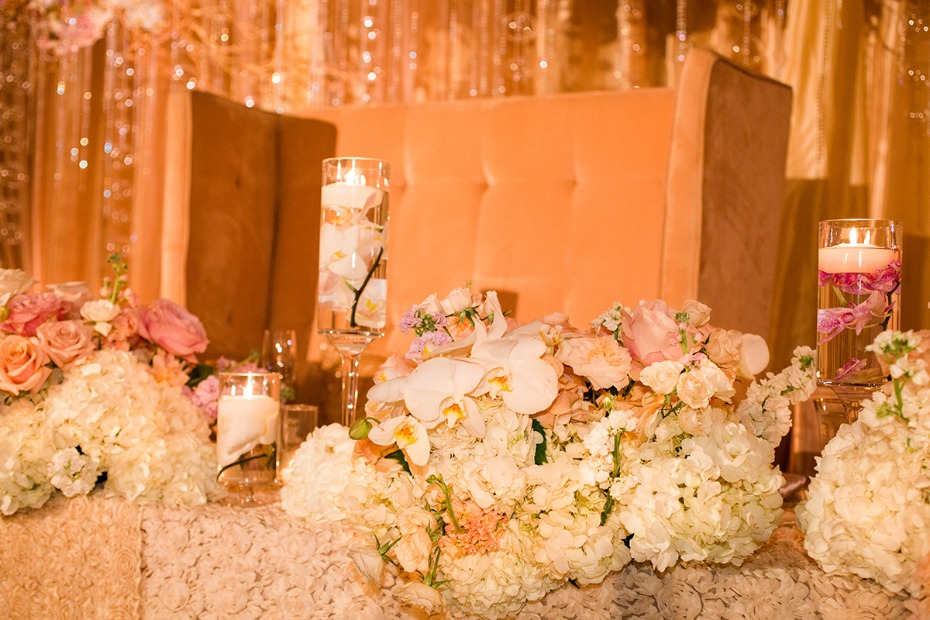 Lavish sweetheart table covered in flowers