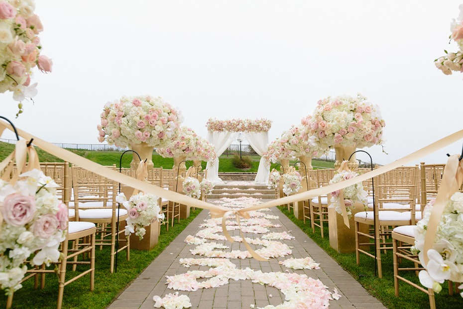 Lavish ceremony decor filled with flowers