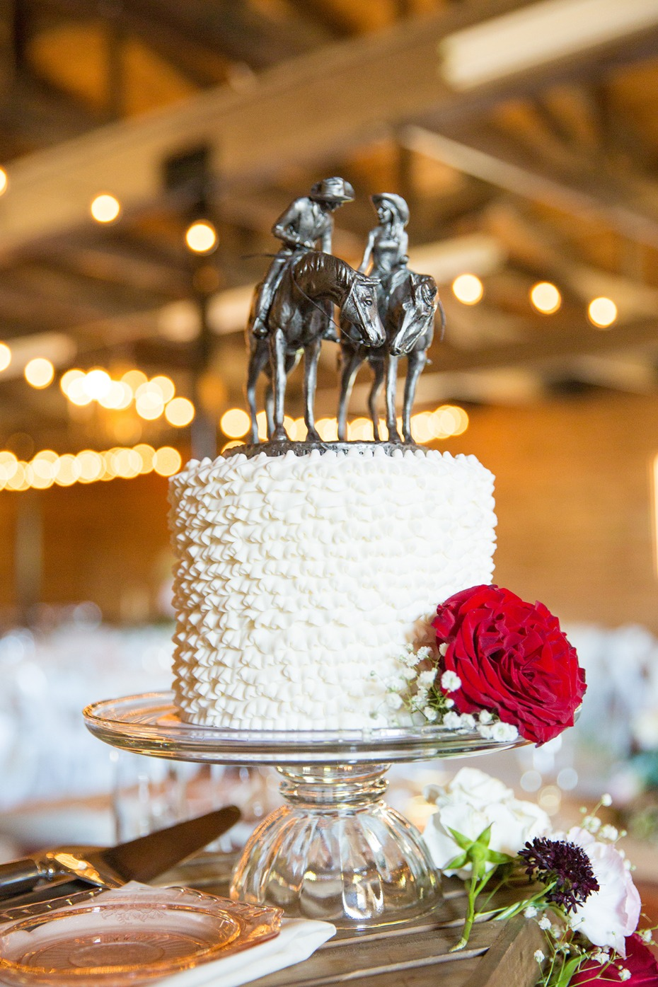sweet and simple wedding cake with custom cake topper