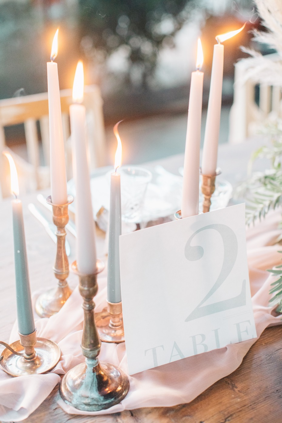 Tapered candles and modern table number