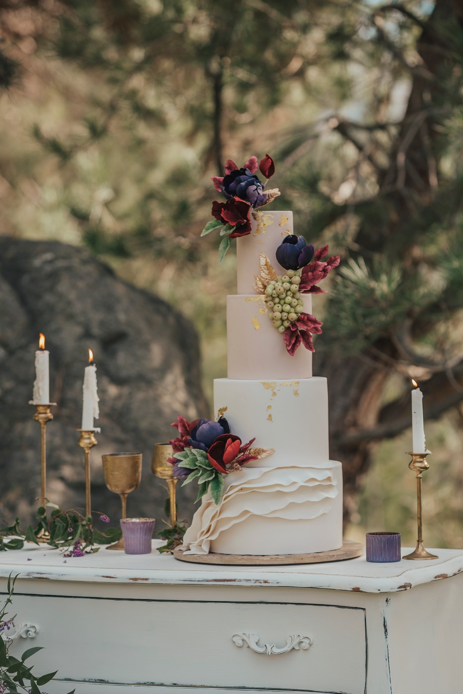 Gold foil wedding cake with edible flowers