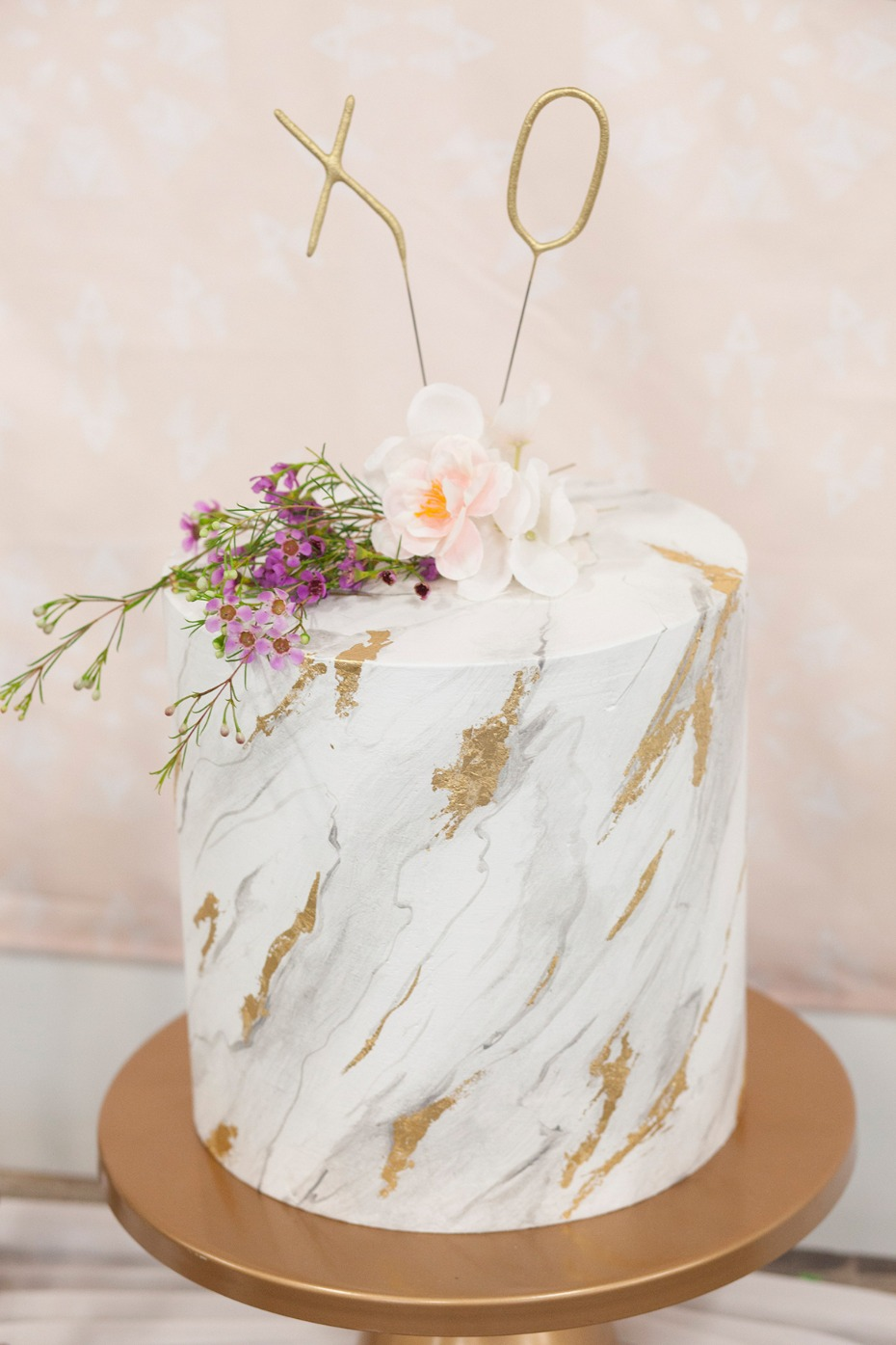 marbled and gold leaf wedding cake