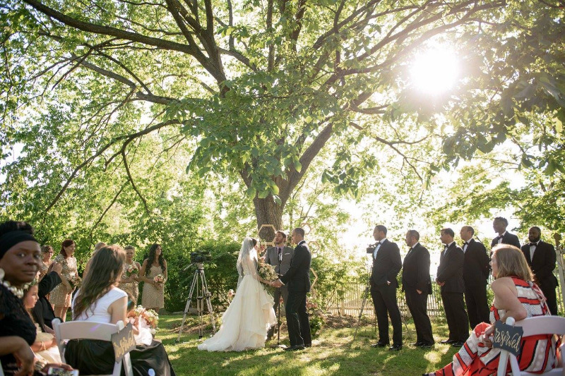 A beautiful June wedding ceremony in the gardens at FEAST at Round Hill, Hudson Valley wedding venue. Photography by George Street