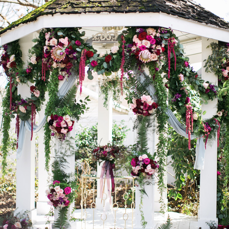 We always love what Enchanted Florist does with our gazebo, but this one really made us swoon! So much garland in the garden - we are