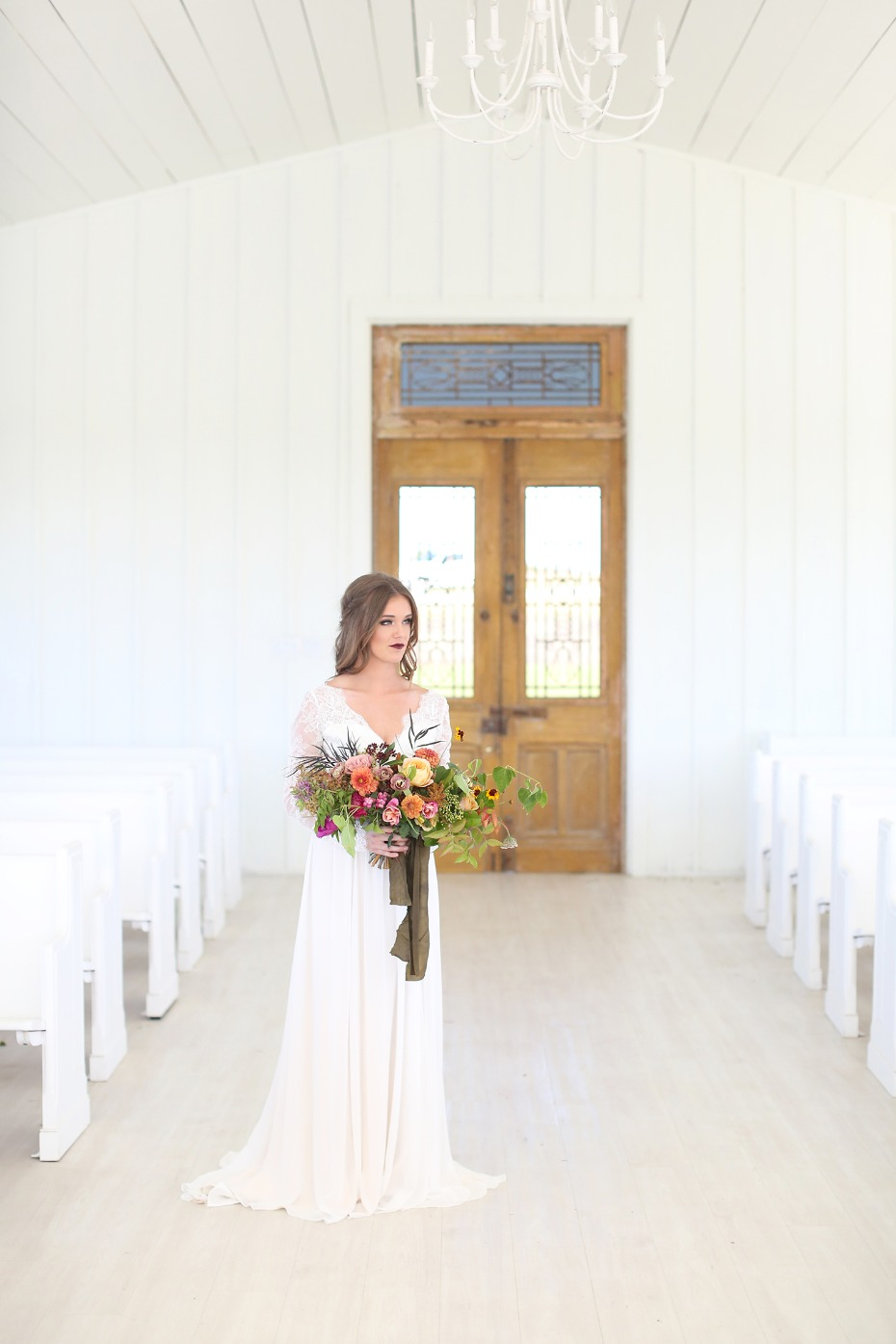 Modern bride with jewel-tone bouquet