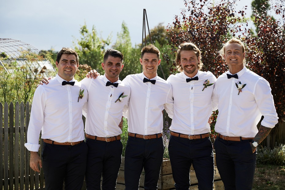 grooms men and groom in white and black
