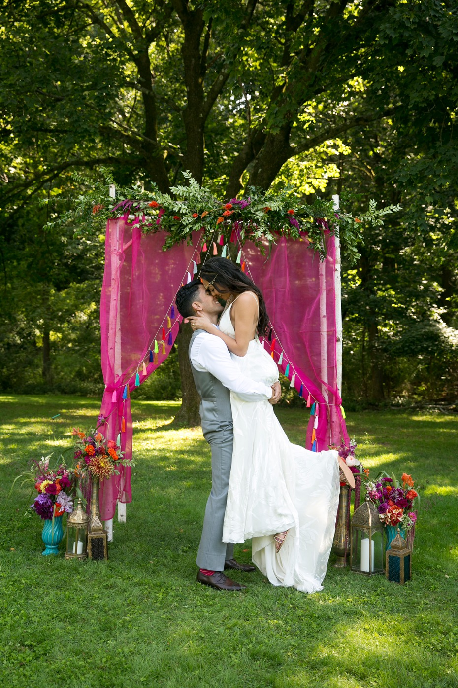 happy bride and groom with whimsical boho moroccan style backdrop