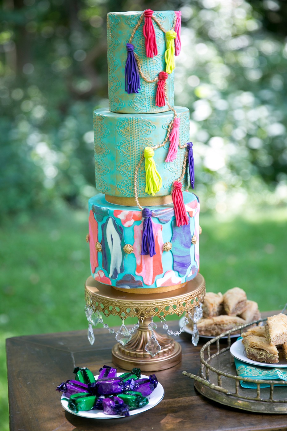 whimsical tassel cake in teal and gold