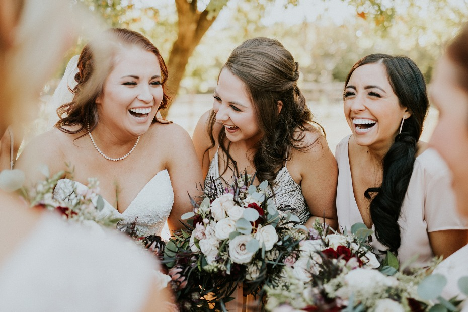 sweet bride and her bridesmaids candid photo