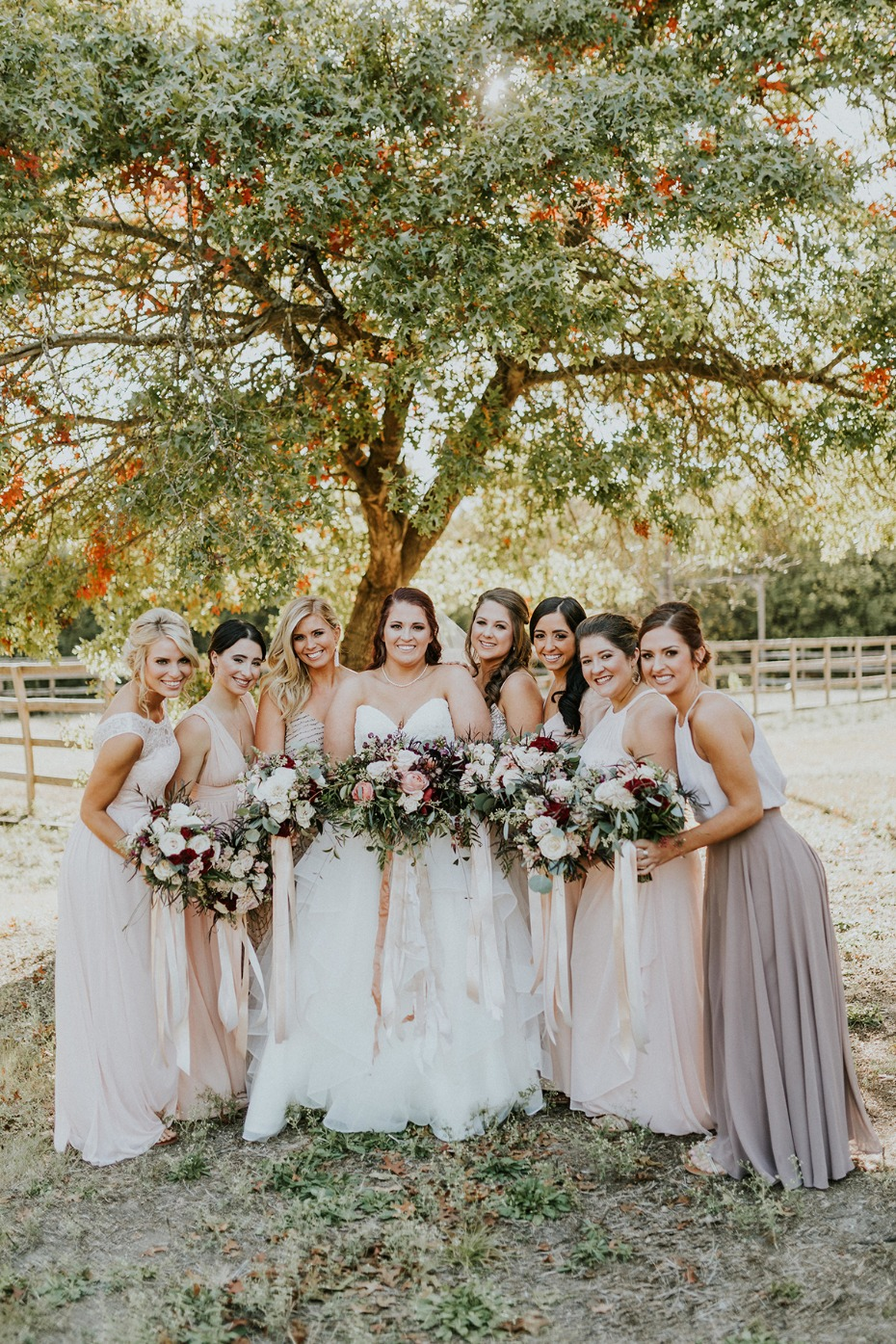 bride and all her bridesmaids in blush and gold