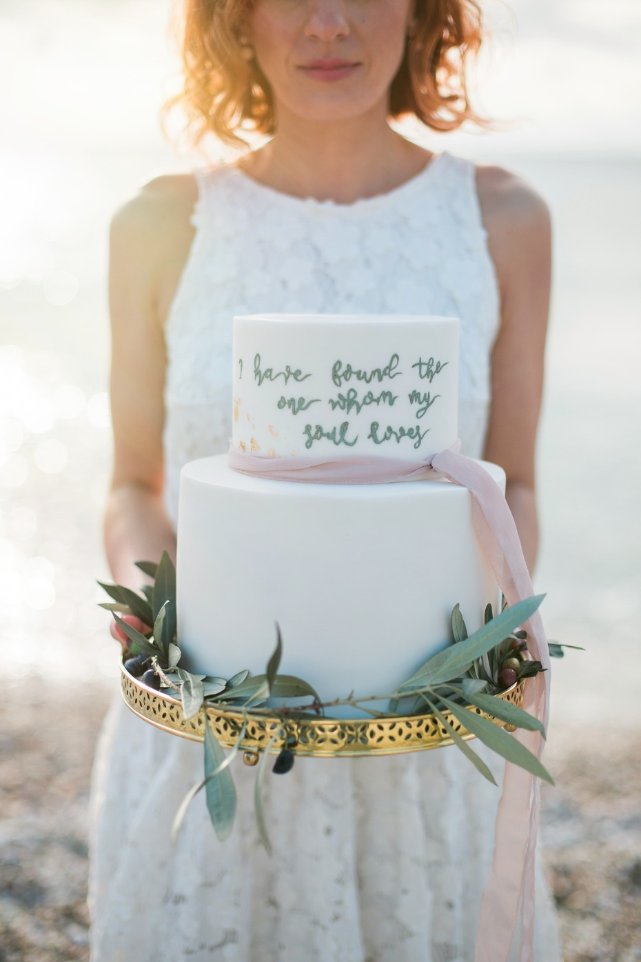 White wedding cake with love quote
