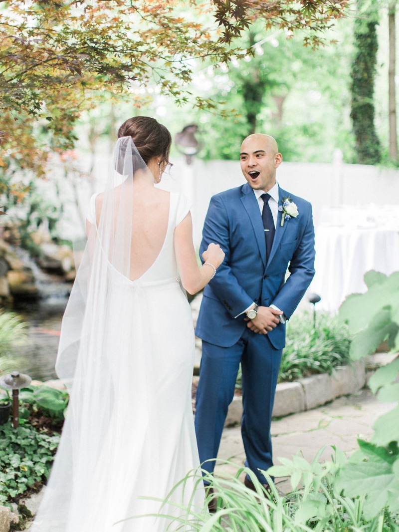 The most epic first look ever! See more from this rustic blue garden wedding at Nashville wedding venue CJ's Off the Square.