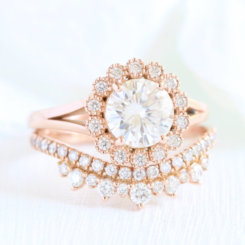 Shop this beautiful vintage meets modern bridal set, featuring a vintage luna halo moissanite engagement ring and a crown diamond wedding
