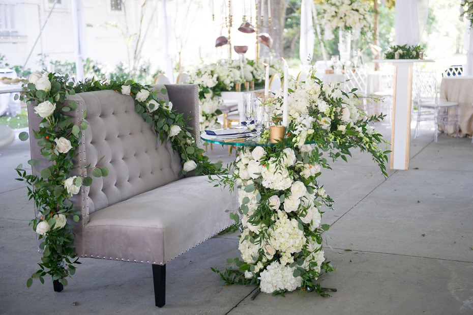 white floral accented sweetheart table