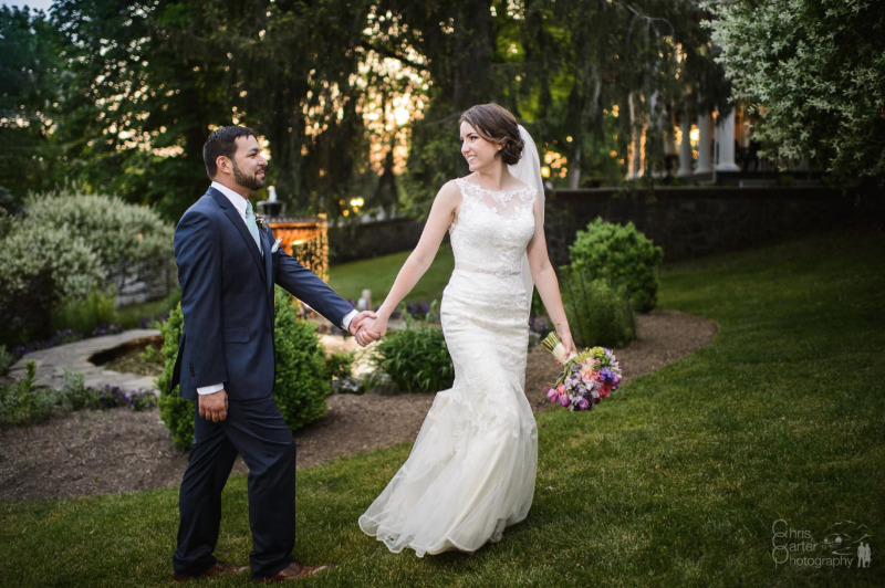 Strolling through the gardens at FEAST at Round Hill, Hudson Valley, New York, wedding venue. Photo by Chris Carter Photography.