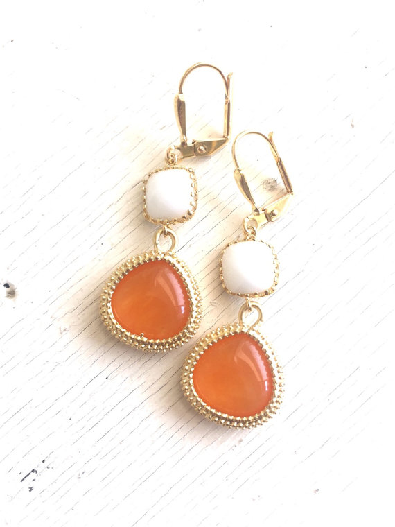 Orange, white, and gold are paired beautifully in these elegant and stunning earrings. Alive and gorgeous, these earrings will add