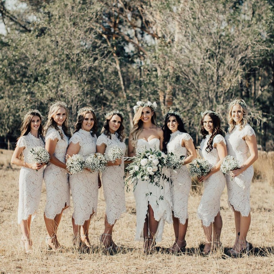 Bridesmaids in white cap sleeve dresses
