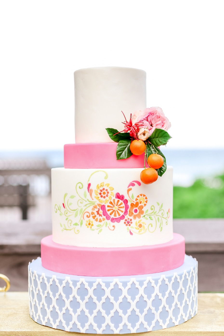 Bright and cheerful cake with pink, blue and white