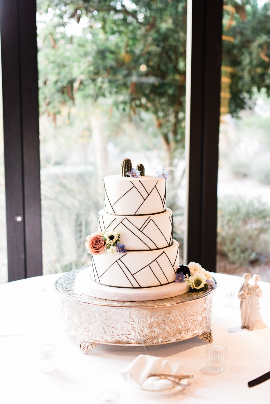 Modern wedding cake with cactus toppers