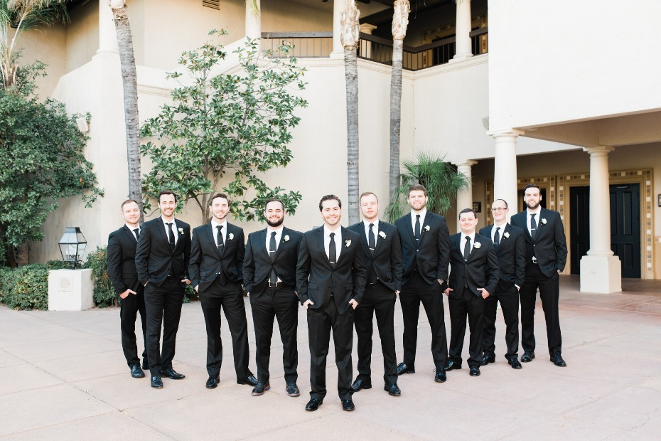 Groom and men in black suits