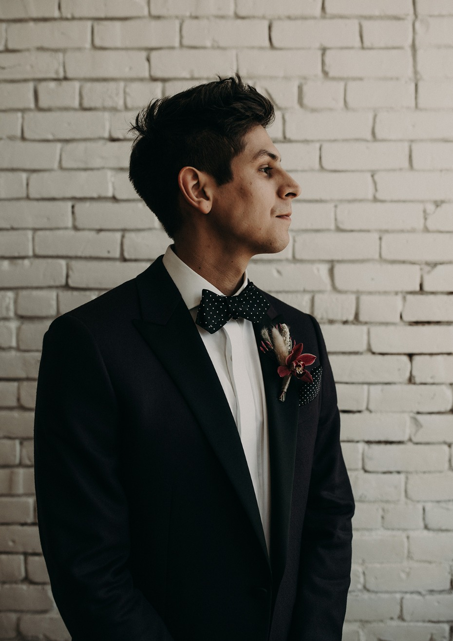 groom in bow tie and suit