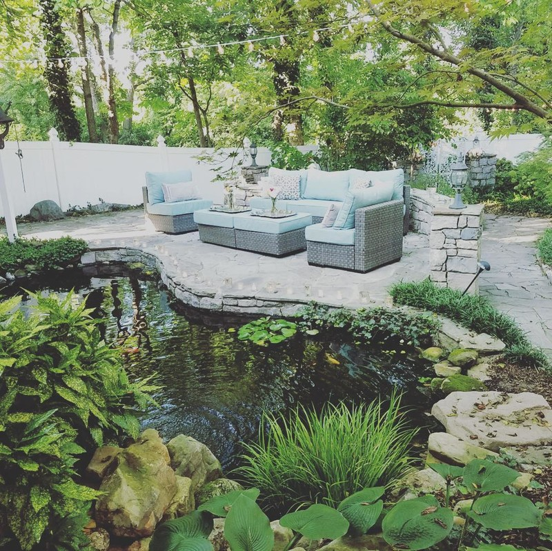 What a perfect summer evening to enjoy a cocktail by the pond with Sutton furniture from